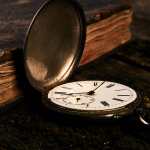 Antique pocket watch and book.